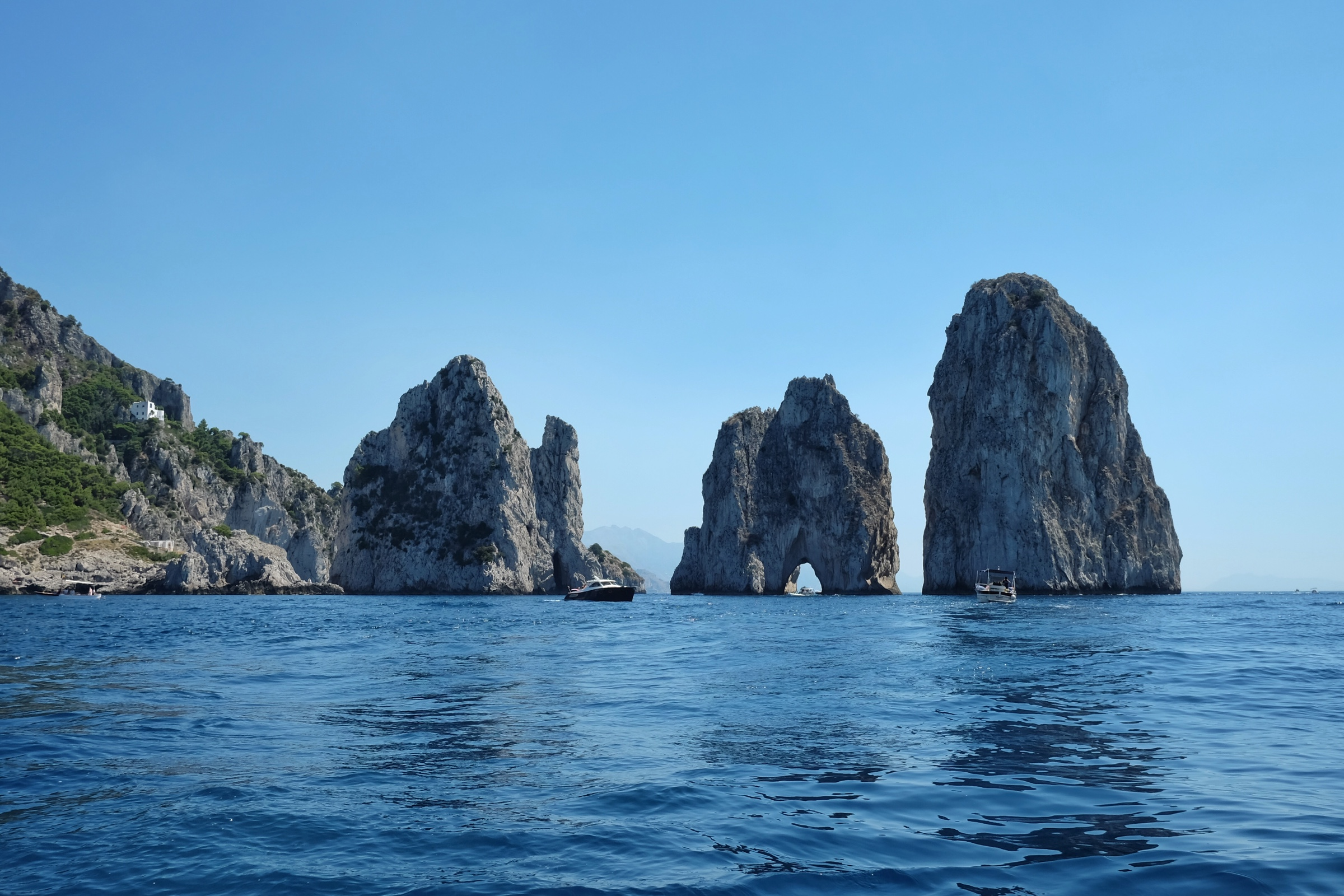 The Faraglioni are the famous three rocks off of Capri.