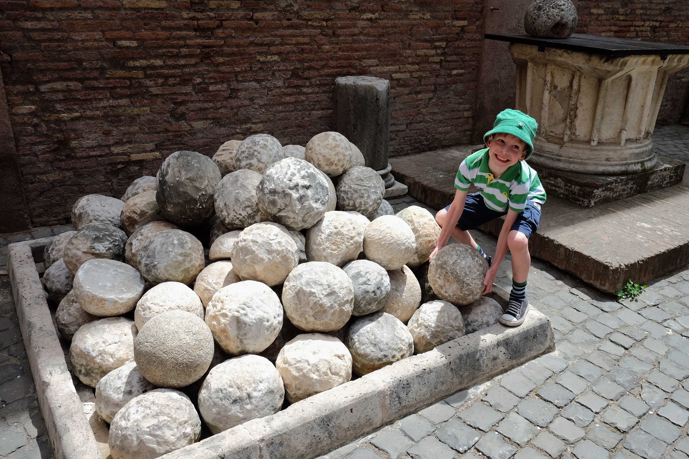 Rowan trying to lift a catapult rock at Castel Sant'Angelo.