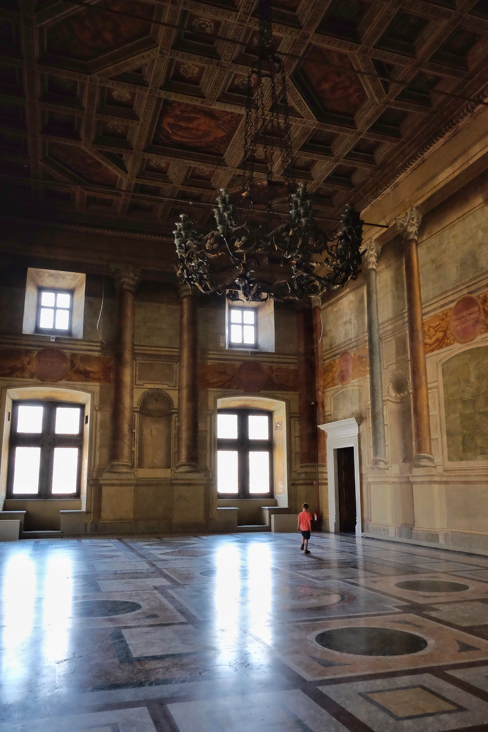 Rowan strolling through one of the gorgeous rooms in Palazzo Venezia.